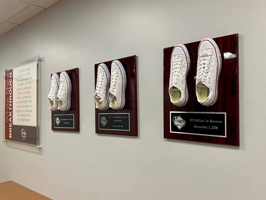 White shoes mounted on wall plaques